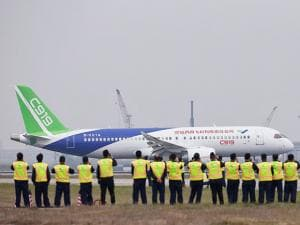 A Chinese-made C919 passenger jet prepares to take off on its first flight at Pudong International Airport in Shanghai