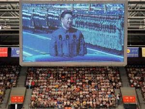 A television broadcast shows Chinese President Xi Jinping