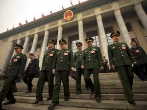 Delegates from the Chinese People's Liberation Army (PLA) leave the Great Hall of the People in Beijing