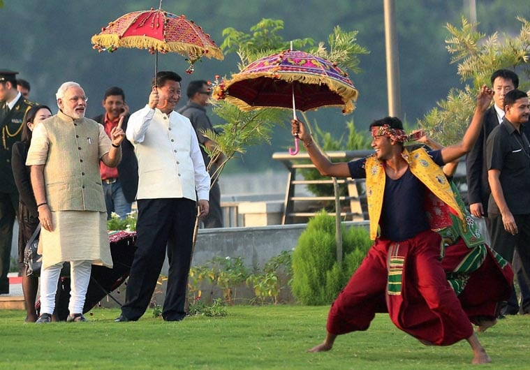 Prime Minister, Narendra Modi, Chinese President, Xi Jinping, holding, umbrella, watch, cultural, performance,  walk, Sabarmati River front, Ahmedabad