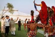 Prime Minister Narendra Modi and Chinese President Xi Jinping watch a cultural performance