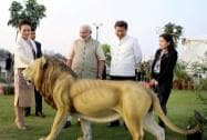 Prime Minister Narendra Modi, Chinese President Xi Jinping and his wife Peng Liyuan admiring a lion statue