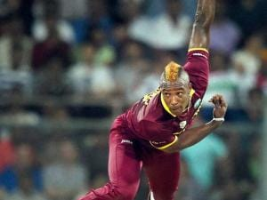 West Indies' Andre Russell bowls a delivery during an ICC WT20 match against England at Wankhede Stadium