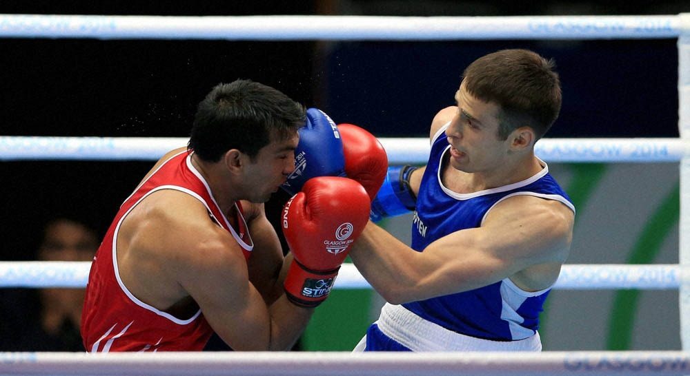 Manoj Kumar, celebrates, winning, fight, Canada's, Arthur Biyarslanov, Men's Light Welter, (64kg), Round16, 2014 Commonwealth Games, Glasgow