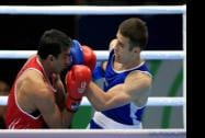 Manoj Kumar celebrates winning his fight against Canada's Arthur Biyarslanov