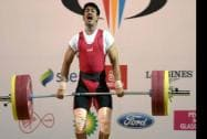 Omkar Otari competes in the Men's 69kg weightlifting final