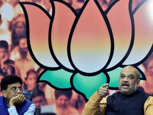 BJP President Amit Shah along with Union Minister Piyush Goyal addresses the media at the party office