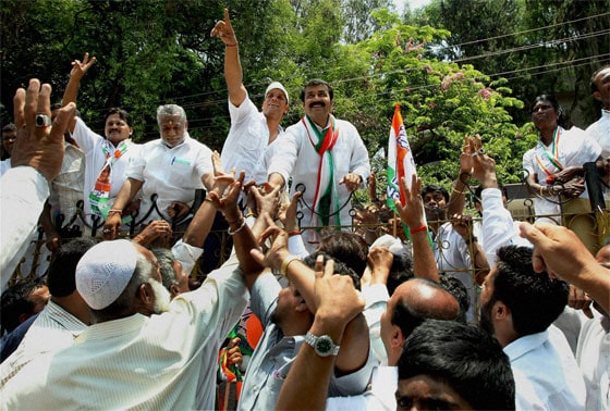 Congress Party candidate N A Harris is greeted by party workers after his win from Shantinagar Assembly in Bengaluru