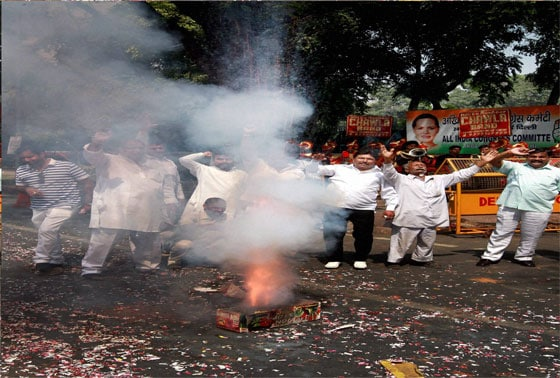 Congress supporters burst crackers as the celebrate the party's victory in Karnataka Assembly polls, outside AICC headquarters in New Delhi