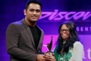 Cricketer M S Dhoni gives the Positive Health Award to acid attack survivor Laxmi