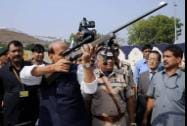 Home Minister Rajnath Singh inspects a weapon