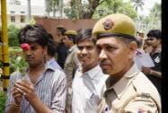 Police detain  IAS aspirants during their protest against introduction of CSAT in Civil Services Exams outside the UPSC