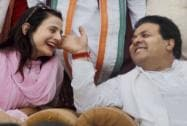 Amisha Patel with Rajeev Shukla during an election campaign