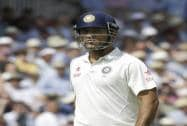 India's MS Dhoni leaves the field after being caught by Matt Prior off the bowling of England's Stuart