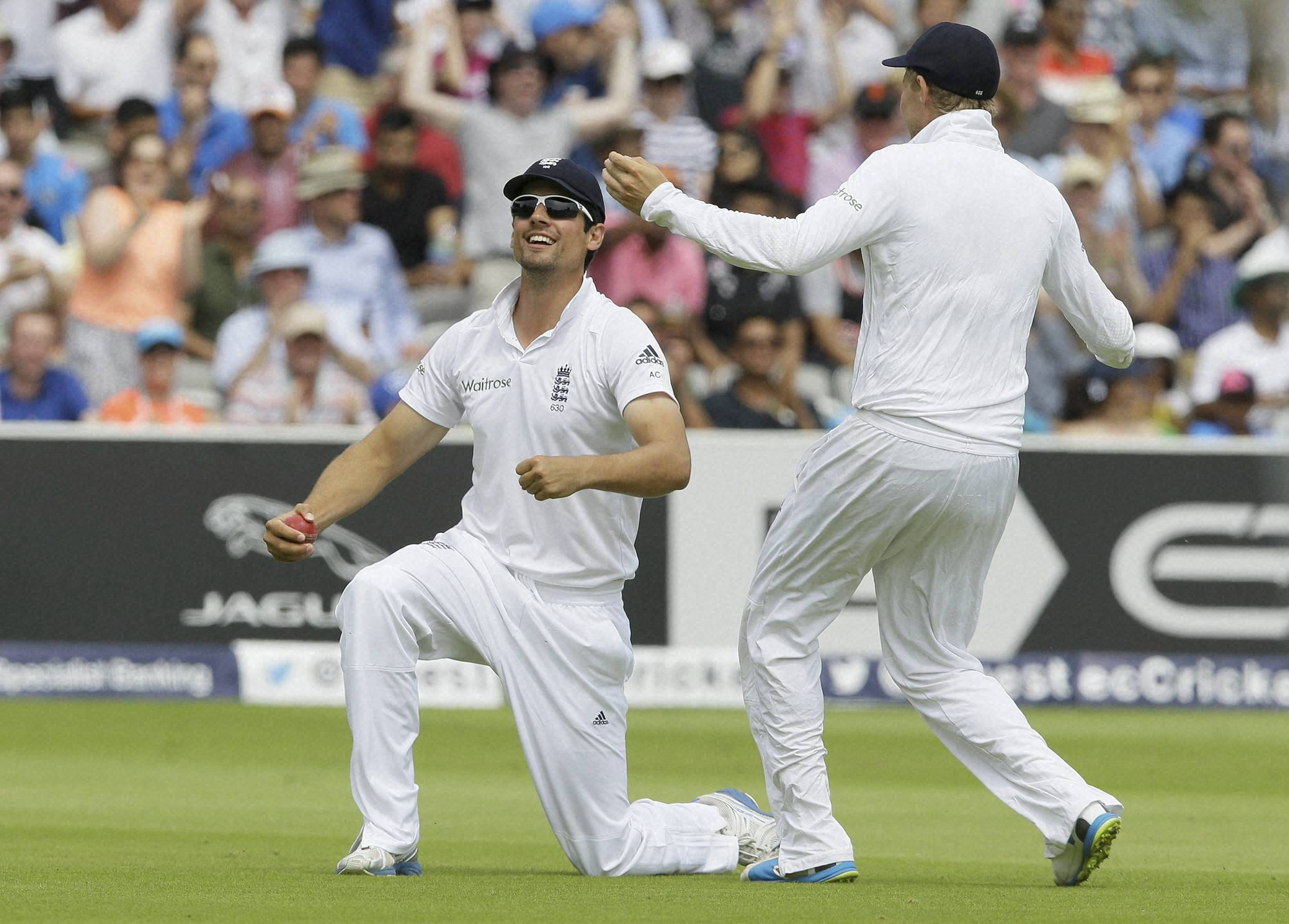 England's, captain Alastair Cook, celebrates, Joe Root, catches, out, India's, Stuart Binny, fourth day, second test match, England, India, Lord's cricket , London