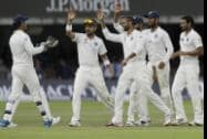 India's players celebrate the wicket of England's Gary Ballance