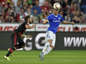 Darmstadt's Luca Caldirola challenges for the ball with Leverkusen's Hakan Calhanoglu