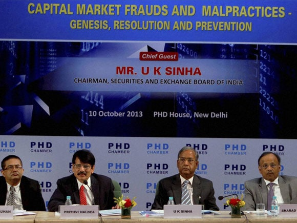 Capital Market Frauds and Malpractices : Genesis, Resolution and Prevention,SEBI ,SEBI Chairman U K Sinha,Sr. Vice President of PHD Chamber Sharad Jaipuria, Chitra Ramkrishna (R), MD & CEO of National Stock Exhange of India Ltd., Prithvi Haldea (2nd L), Chairman of Capital Market Committee of PHD Chamber and MD & CEO of BSE Ltd. Ashish Kumar Chauhan (L)