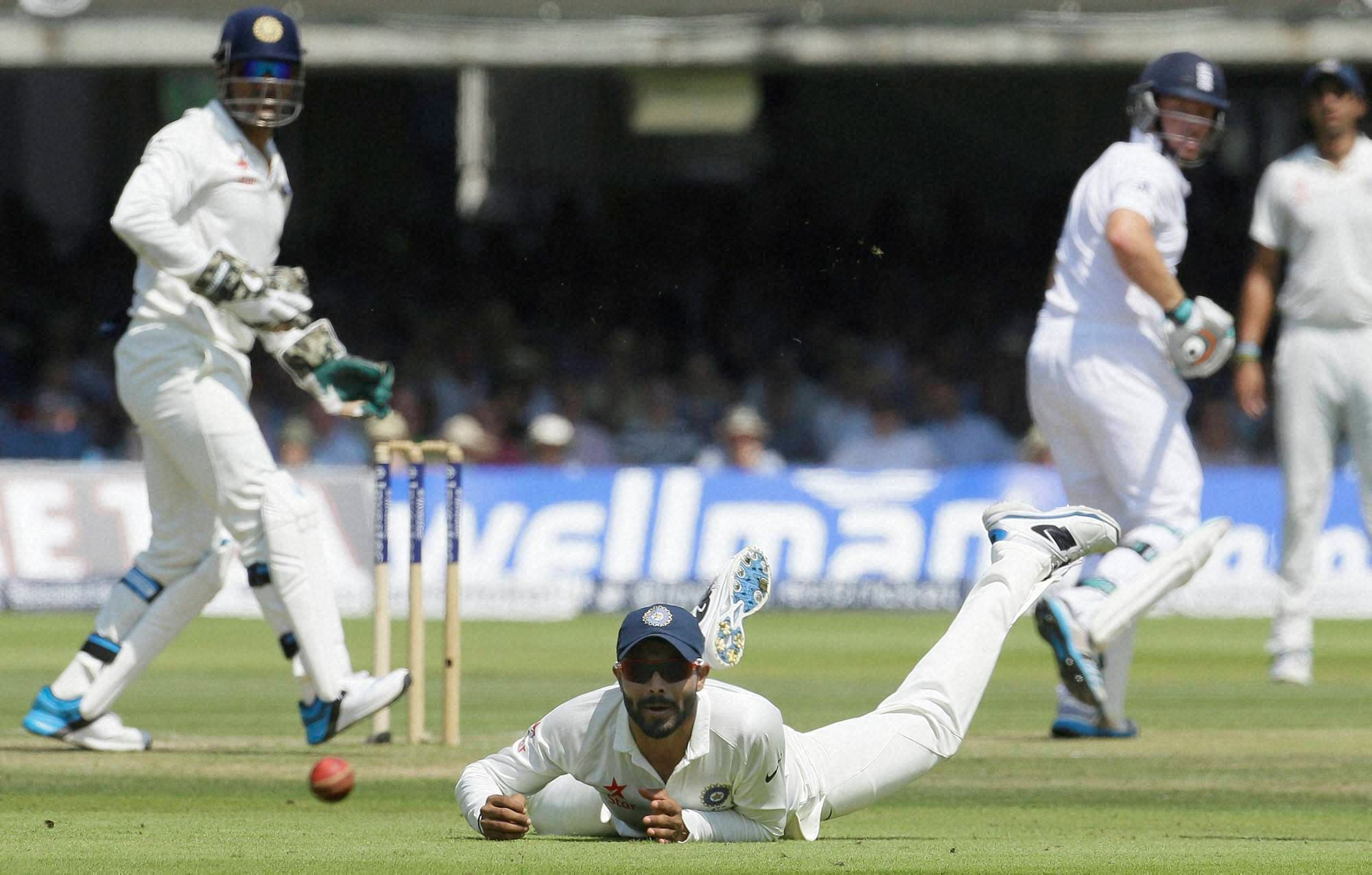 India's, Ravindra Jadeja, fails, stop ball,England's, Ian Bell, India's, Bhuvneshwar Kumar, second day, second test match, England, India, Lord's, cricket, London