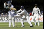 England's Moeen Ali plays a shot off the bowling of India's Ravindra Jadeja