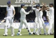 India's players celebrate taking the wicket of England's captain Alastair Cook
