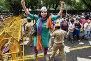 A woman AAP member protesting outside the Union HRD Minister Smriti Irani's residence in New Delhi