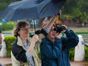 Tourists take pictures during the  monsoon rains in New Delhi