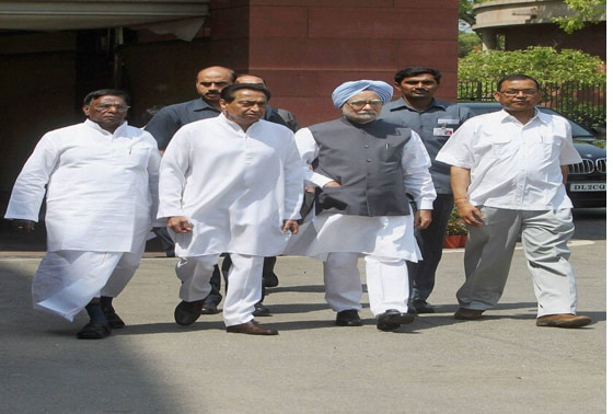 PM  flanked by Kamal NathMinisters of State V Narayanasamy and Paban Singh Ghatowar, arrives to interact with the media on the first day of the 2nd phase of budget session at Parliament