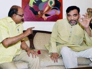 Delhi Transport Minister Gopal Rai trying to convince BJP MP Vijay Goel not to violate odd-even rules, in New Delhi