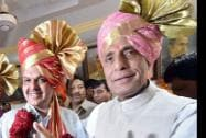 Home Minister Rajnath Singh flashes victory sign after he announced Devendra Fadnavis as the new Maharashtra Chief Minister