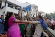 Supporters of Devendra Fadnavis celebrate after he was elected as BJP legislative party meeting