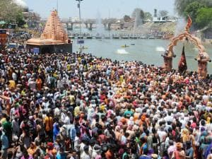 Naga Sadhus take holy dip in Kshipra River on the first 'Shahi Snan' in Simhastha Mahakumbh in Ujjain, Madhya Pradesh