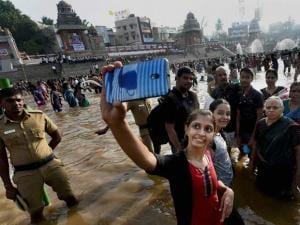 Devotees taking selfie after the holy bath at the Kumbakonam Mahamaham pond on the occasion of the Mahamaham festival 2016 in Kumbakonam