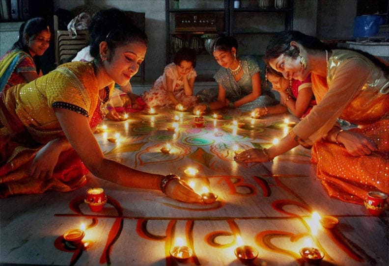 Young, girls, light, earthen lamps, Diwali, festival, celebration, Allahabad