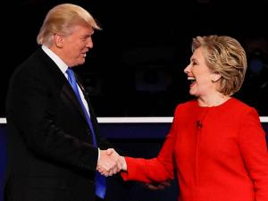 Republican presidential nominee Donald Trump shakes hands with Democratic presidential nominee Hillary Clinton