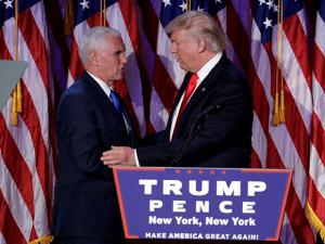 President-elect Donald Trump shakes hands with Vice-President-elect Mike Pence