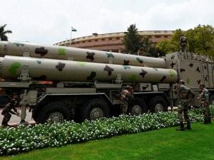 Army personnel display a missile system at Parliament House in New Delhi