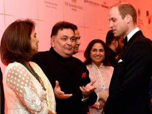 Prince William, Duke of Cambridge with actors Nitu Kapoor and Rishi Kapoor during the Bollywood theme dinner in Mumbai.