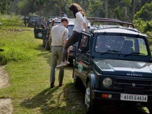 Catherine (Kate), Duchess of Cambridge jumps from a jeep during Safari ride inside the Kaziranga National Park of Assam, on Wednesday. Also seen in the picture is  Prince William_02