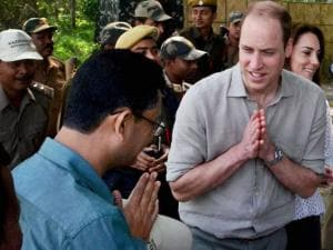 Prince William, Duke of Cambridge and his wife Catherine (Kate), Duchess of Cambridge interacts with a forest official in Kaziranga National Park, Assam