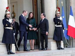 French President Francois Hollande shakes hands with Prince William and Kate
