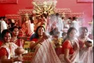 Married women dance as they participate in Sindur Khela