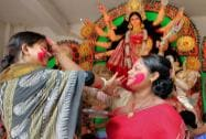 Married women participate in 'Sindur Khela' at a Durga puja pandal