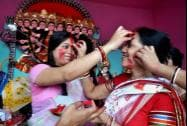 Married women playing with vermillion powder on the occasion of Vijaya Dashmi