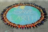 School students giving a message to save environment in a programme on the occasion of World Earth Day