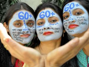 Women with their faces painted to on the eve of 60th Earth Hour in Muradabad