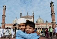 Children greeting each other after 'Eid- Ul-Fitr' prayers at Jama Masjid