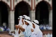 Muslim boys offer prayers on the occasion of  'Eid- Ul-Fitr' at Jama Masjid