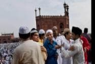 Muslims greet each other after offering prayers