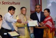 Textile Minister Santosh Kumar Gangwar felicitates a woman achiever in sericulture